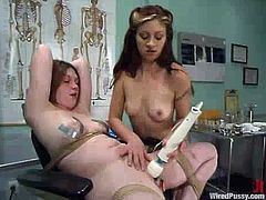 Carly binds her chubby redhead GF Ginger and plays with her fleshy snatch. Carly rubs Ginger's twat ardently and then smashes it with a toy.