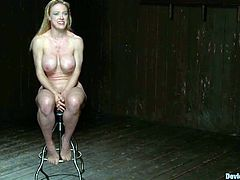 Busty blonde Darling is having fun with some guy in a basement. The man puts the hottie into irons and then pulls her by the nipples and smashes her coochie with dildos.