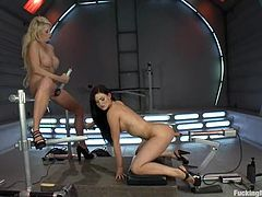 Blonde and brunette babes take their clothes off and lick each others pussies. After that they get toyed deep and hard by fucking machines.