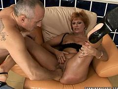 Horn made red-haired mom in steamy black lingerie lies on leather couch with legs wide open getting her vagina fingered by horny dad and stretched with all kind of shit.