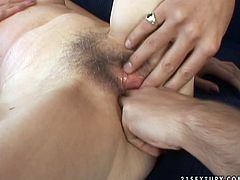 Foxy mature slut gets her hairy pussy finger fucked in missionary style and drilled in doggy style position. She enjoys playful hands of one young dude and his stiff cock.