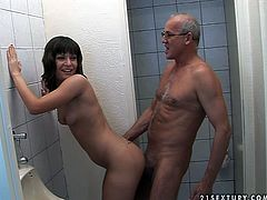 Trading brunette MILF makes out with a filthy grey-haired dad in public toilet. She bends as he pokes her cunt from behind before she ride his cock reverse as he sits on the toilet bowl.