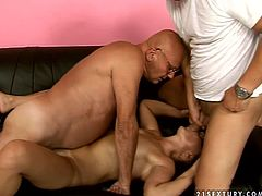 Queer old slut is banged hard from behind by perverted doc while sucking old fart's cock. Then, old grandpa nailed her hairy pussy in a missionary position. In the end of the porn clip hussy granny gets double portion of facial cumshot. Dirty Doc is also pissing onto filthy granny in the end of the session.