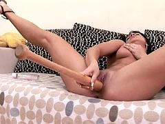 Professional porn actress Lee Lexxus likes it harder and uses baseball bat to satisfy her stretched twat. She spreads her legs wide and fucks her cunt with baseball bat.