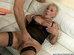 Vulgar bootyful blond mature with tattooed hands gets her pussy nailed by dildo machine as she stands in doggy pose wearing peppering black lingerie and stockings before a horny daddy starts fisting it in sultry sex video by 21 Sextury.