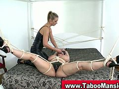 This blonde dominant female spanks her slave hard before she tortures her massive natural tits making them turn red.