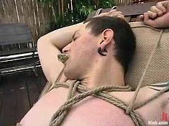 Slim brunette chick ties up and gags Judas. Then she tears his ass up with a strap-on. In addition she gives him some painful handjob.