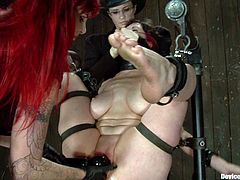 Brunette girl gets chained and whipped. Later on Mz Berlin fixes lots of clothespins to Nerine's body. Then the brunette also gets her pussy toyed and fingered.