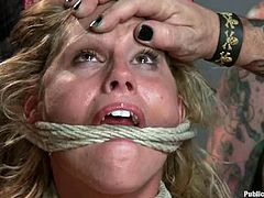 Cute curvy blonde is having fun with a few men in a basement. She gets chained and enjoys big cocks in her mouth, coochie and asshole.