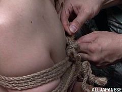 A military officer is out surveying the field when she is captured by enemies. They strip her naked and tie her with rope. She is thrown in prison and has hook placed in her nose. The hooks are pulled up causing her pain. She and a fellow prisoner have to suck dick to earn their freedom.