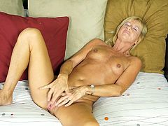 Watch this solo video where the mature blonde Casey Ivy plays with her shaved pussy as she lays back on her couch.