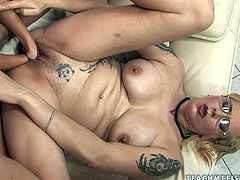 Fugly blond Goth girl with nasty tattoos all over he slack body gets her hairy vagina fingered and later fisted by rapacious brunette hottie in perverse sex video by 21 Sextury.