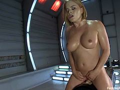 Cute busty chick Krissy Lynn is getting naughty indoors. She oils her big boobs, caresses herself and then jumps on a fucking machine crazily.
