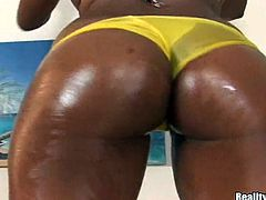 Bubble-butt ebony chick Vixxen oils her ass and demonstrates it to her man. Then she gives him a blowjob and jumps on his schlong in cowgirl position.