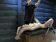 Lilly LaBeau gets her pussy toyed and fingered in BDSM scene