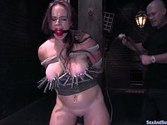 This smoking hot babe loves it in pain. She gets hanged on her hair and then that huge cock penetrates her waxed ass from behind!