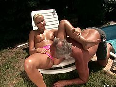 This bearded fat daddy is really lucky as he gets to make out with this peppering blonde student. She sits on the deck chair by the pool while he pisses into her spoiled mouth. Later she pleases him with a through blowjob.