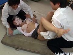 Sex hungry Japanese teacher has wild threesome sex with two her students. She sucks their dicks passionately and then gets pounded on on the floor right in a classroom.
