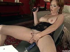 Slutty chick Audrey Hollander is having fun in her room. She pleases herself with pussy-fingering and then gets her cunt and butt smashed by a fucking machine.