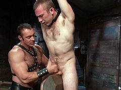 See how this gay guy gets his ass spanked and fucked as well as his throat in this BDSM gay porn video with domination and bondage.