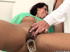 This doctor knows his job well. He rubs oil all over her patient's hairy twat and then he shoves a special medical device inside her snatch to check if it is completely recovered. After getting her snatch examined horny gynecologist tells her that her pussy looks very healthy. Then she rewards him with a blowjob.