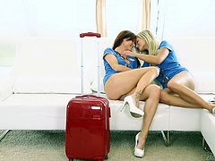 This sexy redhead and her blonde partner has just finished a long flight from New York to London and now they are super horny. Watch as the blonde kisses the redhead and sucks on her nipples. These two lesbians are sexy and eager to fuck!