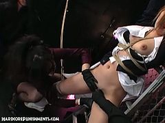 Hairy pussy Japanese toyed hard while tied and she's enjoying this kinky encounter to the extremes.