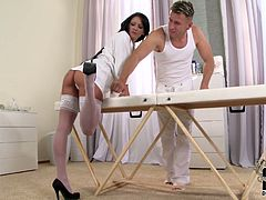 Alluring MILF with gorgeous body is wearing white robe, nylon stockings and high heel shoes. Instead of massaging the client she gets her feet nuzzled and pleased by horny guy having foot fetish. Then she rubs his cock with her smooth soles giving hot foot job.