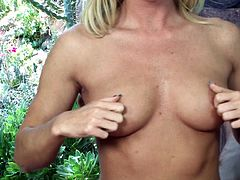 Nikki Young shows what a slutty blonde she is. The babe undresses in a very sensual way and then gropes her boobs. Yeah, she likes that but even more, she likes rubbing her pussy. Nikki spreads her legs wide, puts some spit on her fingers and then slowly rubs her pink tight hole. What a slut!