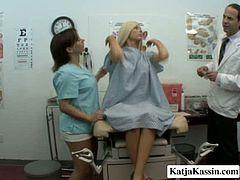 Appealing blonde doll is at the appointment to the Doctor. She takes off her clothes and puts on a robe. The Doc and the nurse seduce her caressing big boobs and wet pussy. Naughty games are going to have place.