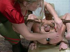The hot busty blonde Dia Zerva is going to strapon fuck this guy in this pegging and femdom session packed with bondage and torturing action.