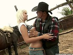 Skanky blond cowgirl hooks up with overaged fat cowboy at his farm. She pulls his pants down before she welcomes a sturdy cock into her mouth to give him a thorough blowjob before he pays her back with a steamy tongue fuck.