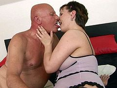 Luscious brunette mom with chunky body and big natural saggy boobs is getting pleased by perverted old man. Then she gives him a head.