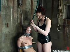 Redhead hottie Claire Adams is getting her punishment in a basement. She gets bound and humiliated and enjoys it when JP hurts her.