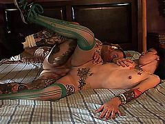 Krysta Kaos will amaze you with all of her tattoo art, along with her naval piercing and green hair but, most of all, you'll love her bubble butt and shaved snatch, that gets finger-fucked by her lover, before sucking his cock, followed by getting laid from behind before getting a pearl necklace.