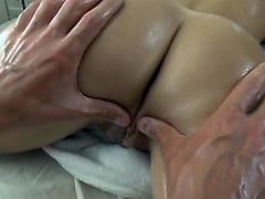 Flat chested brunette gets her tough body oiled. His playful hands slide her oiled body and later he penetrates her juicy pussy in doggy and cowgirl styles.