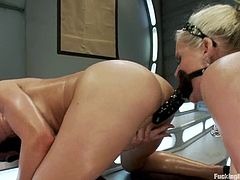 Stunning Amy Brooke and Phoenix Marie oil their asses up and toy each others asses with a strap-on. Later on they get their pussies drilled by fucking machines.