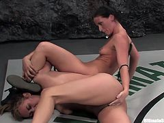 Brunette wrestles a blonde and wins so she gets to fuck her with a strapon & sit on her face, check it out right here! It's fucking hot!