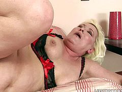 Sex-starved whore with big tits knows how to appreciate a good, stiff cock! She takes her lover's dick in her slutty mouth and sucks it diligently like a dirty whore. She spreads her legs wide to let him finger her snatch and then she gets into sideways position for a good hard fuck.