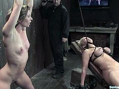 Well-endowed blondes Ariel X and Mellanie Monroe let some dude bind them. Then the man attaches weights onto the chick's tits and rubs their pussies with a vibrator.