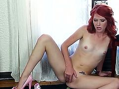 Horny slender redhead Elle Alexandra moans while playing with her shaved and pierced wet pussy