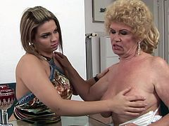 Kinky slim and pale brunette seduces fat old whore with blond hair. Both lesbians undress and kinky blond odlie with saggy tits spreads legs to get her hairy pussy licked right on the couch.