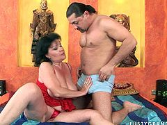 Vast mature BBW in cheap red lingerie gets her oversized slack tits mauled by kinky young dude from behind before she clings to his hard penis to give a thorough blowjob.