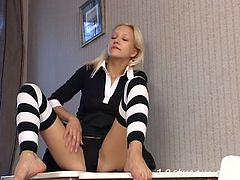 This kinky and filthy blond siren from Russia is going to show you how she masturbates! Honey got a huge toy to insert herself!