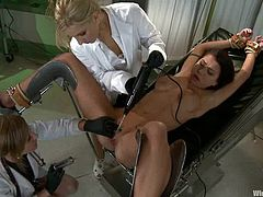 Micah Moore is playing BDSM games with Maitresse Madeline and some other bitch in a hospital ward. Micah lets the girls tie her up and play with her snatch and then they lick each other's juicy cunts.