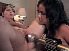 Dana Dearmond and Lorelei Lee are having fun in a bedroom. They stroke each other's nude bodies and then drill one another's vags and butts with a fucking machine.