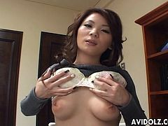 Horny japanese likes to feel her hairy cunt getting wet during her slow fingering