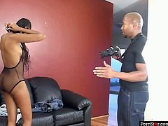 Naive looking black teen goes through audition for porn movie. She puts on a fishnet lingerie before she lies on her back with legs wide open allowing a horny producer tongue fuck her snatch.