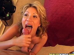 Nasty MILF with huge boobs gives skillful blowjob and then lies down on a bed. She gets fucked rough in different poses and jizzed on her tits.