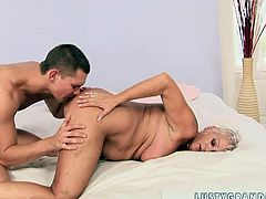 She is an experienced woman when it comes to pleasing men. She sucks her young lover's dick gently to make it hard. She takes that rock hard erection up her loose snatch and rides it likes she's a cowgirl on a bucking bronco. Then she spreads her legs wide to let him enjoy the taste of mature pussy.